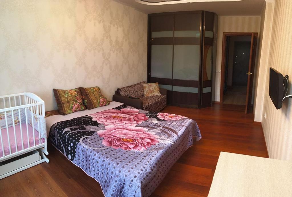 Кровать или кровати в номере Апартаменты у озёра