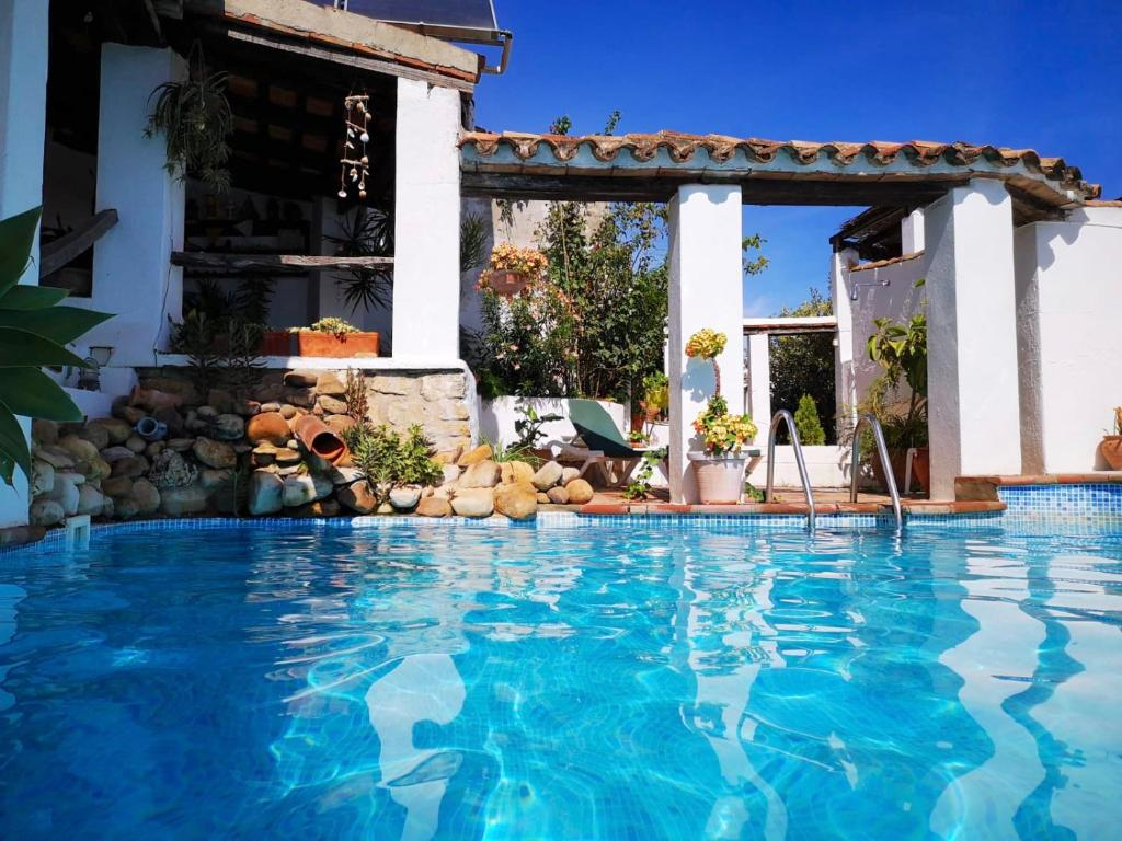 The swimming pool at or near Hostal el Anon