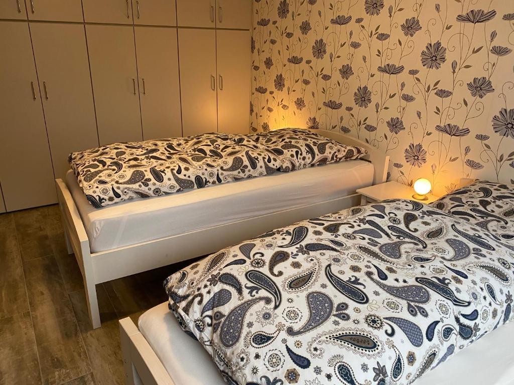 Ein Bett oder Betten in einem Zimmer der Unterkunft möbl. Apartment Nürnberg