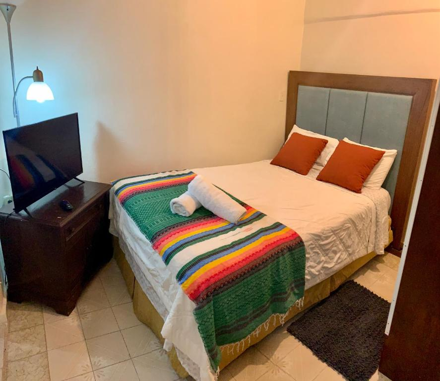 A bed or beds in a room at Casita Natural Village #6