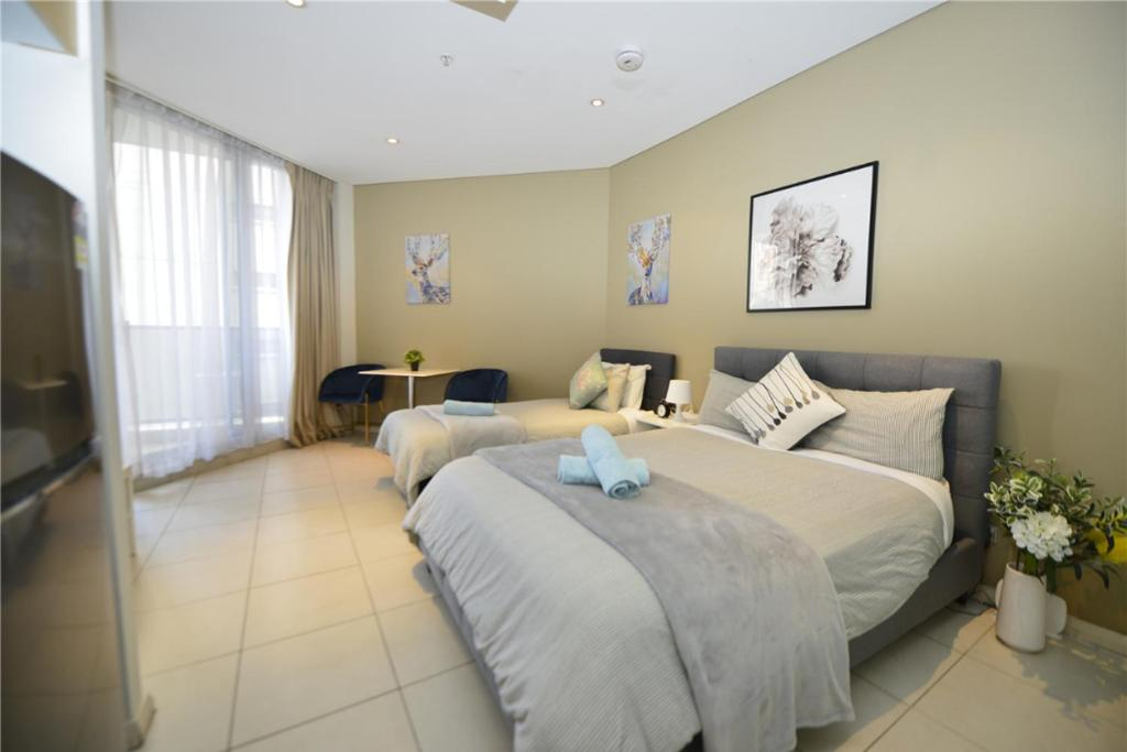 A bed or beds in a room at Alora Studio in Sydney Central - Darling Harbour