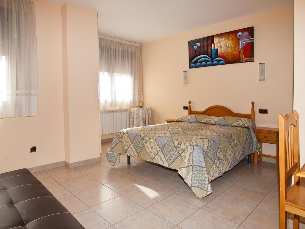 Кровать или кровати в номере Hostal La Maravillosa