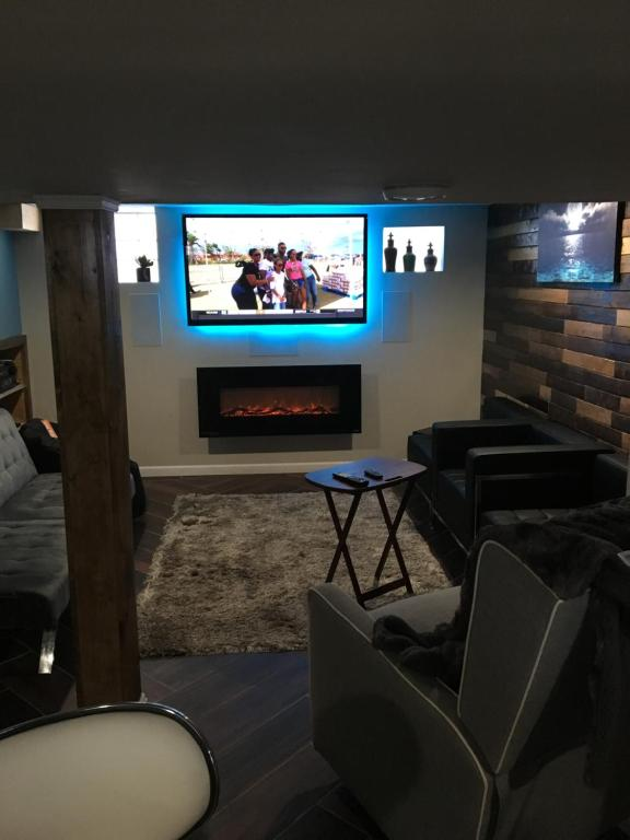 A television and/or entertainment center at Helluva Nyce Basement