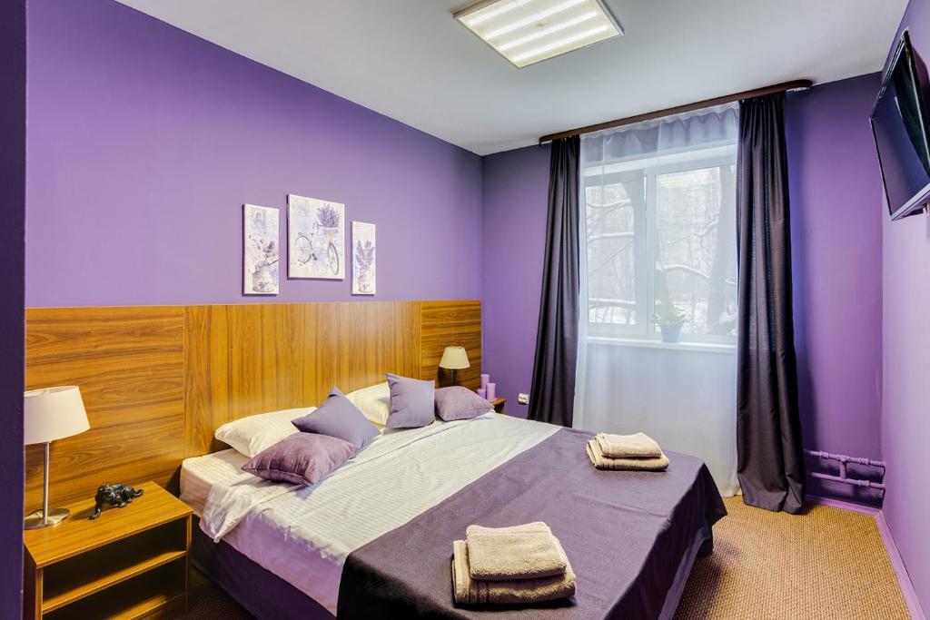 Кровать или кровати в номере Yasenevo Hotel