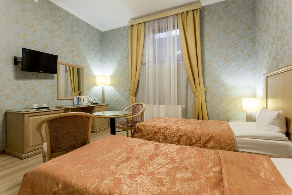 A bed or beds in a room at Art Hotel Nikolaevsky Posad