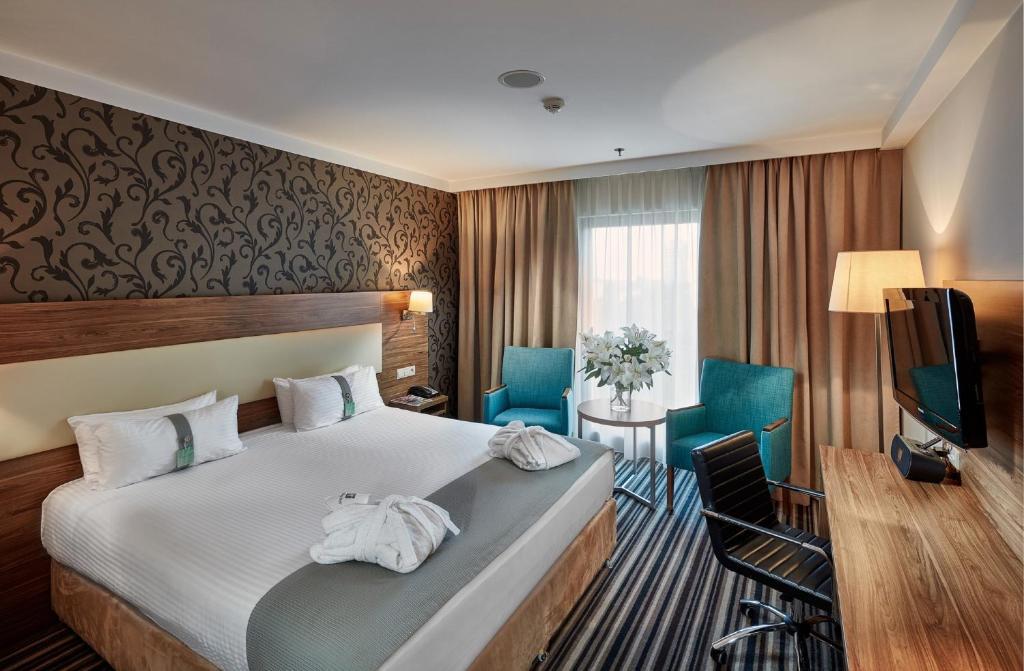 Кровать или кровати в номере Holiday Inn Łódź