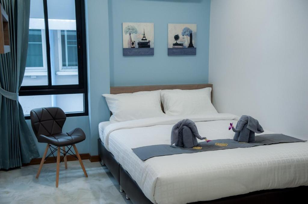 A bed or beds in a room at The Moon Night Hotel