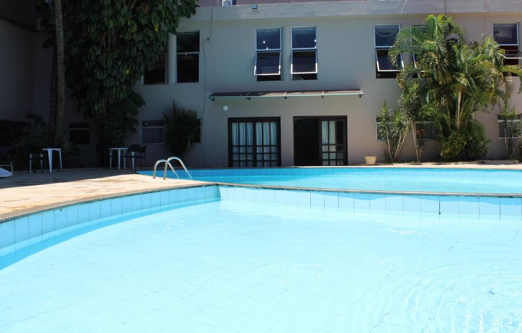 The swimming pool at or near Manacá Hotel