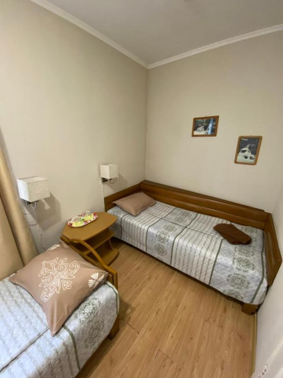 A bed or beds in a room at Mirabel Hotel