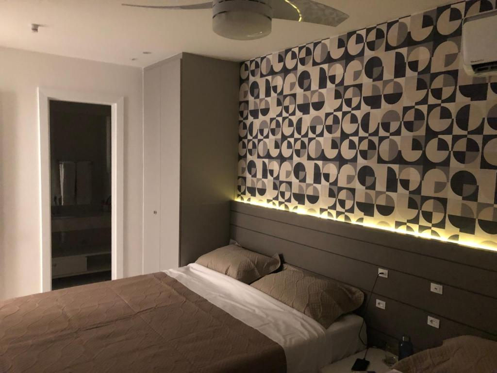 A bed or beds in a room at Golden Lake Resort