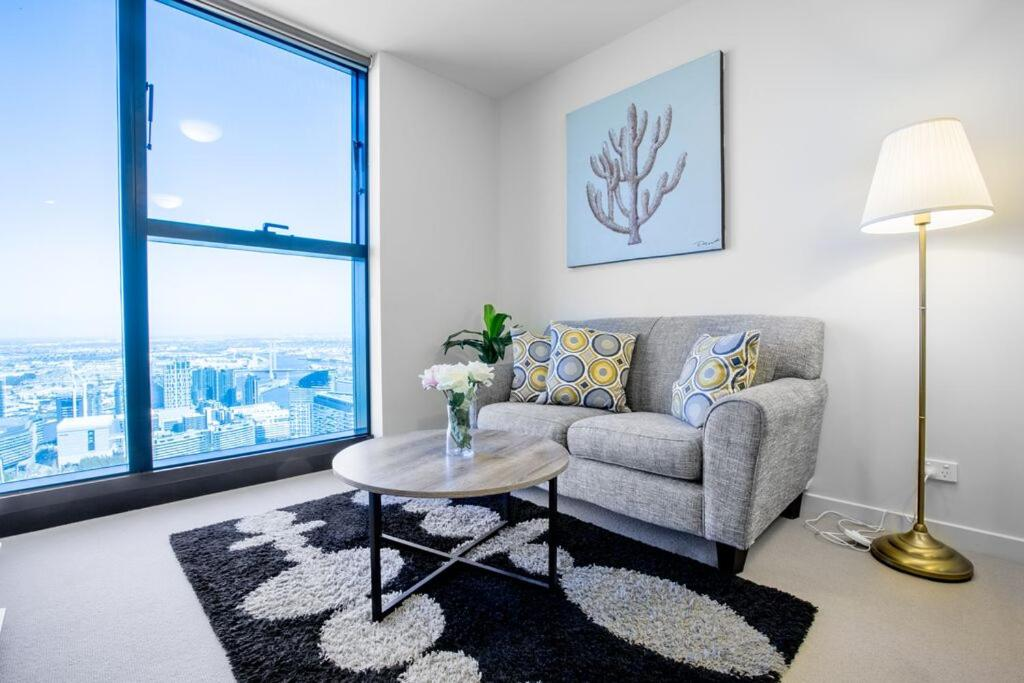 A seating area at 40*CollinsTower*Lvl53*1bd1bth*FreeTram*Skybus*WIFI