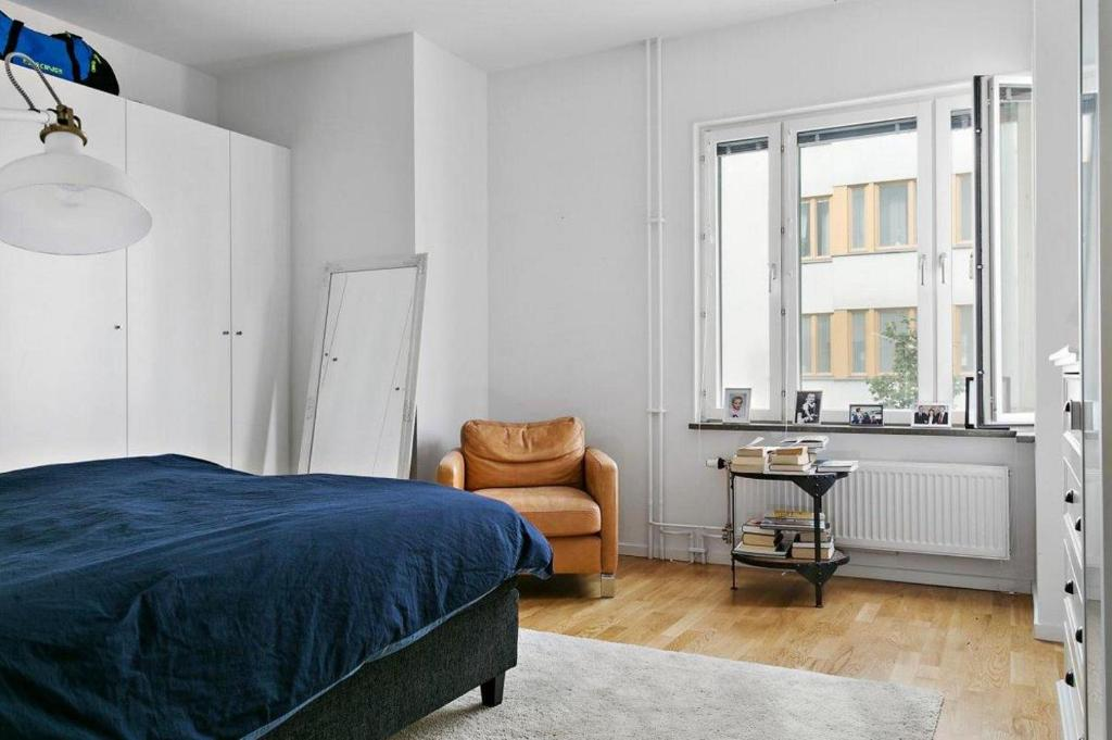 A bed or beds in a room at Exclusive apartment Stockholm