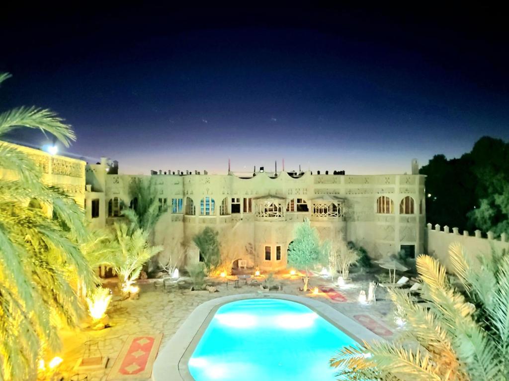 The swimming pool at or near Ksar Merzouga Hotel & Camps