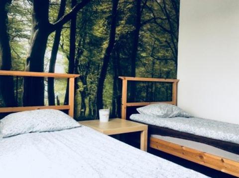 Łóżko lub łóżka w pokoju w obiekcie GoldenHorse