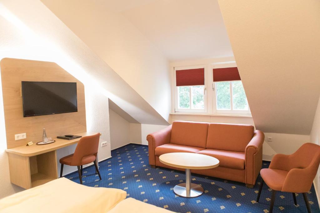 Ein Sitzbereich in der Unterkunft Hotel Restaurant Lathener Marsch