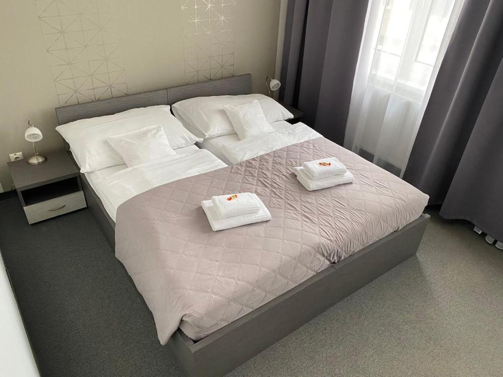 Posteľ alebo postele v izbe v ubytovaní Penzión Sport