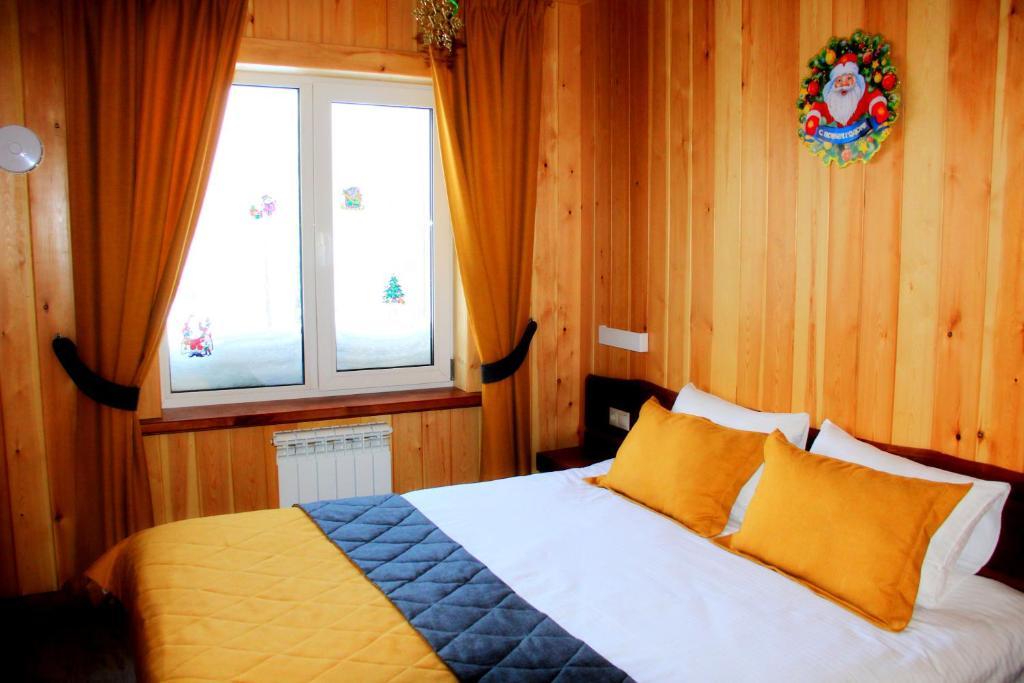 Кровать или кровати в номере Старый Шерегеш