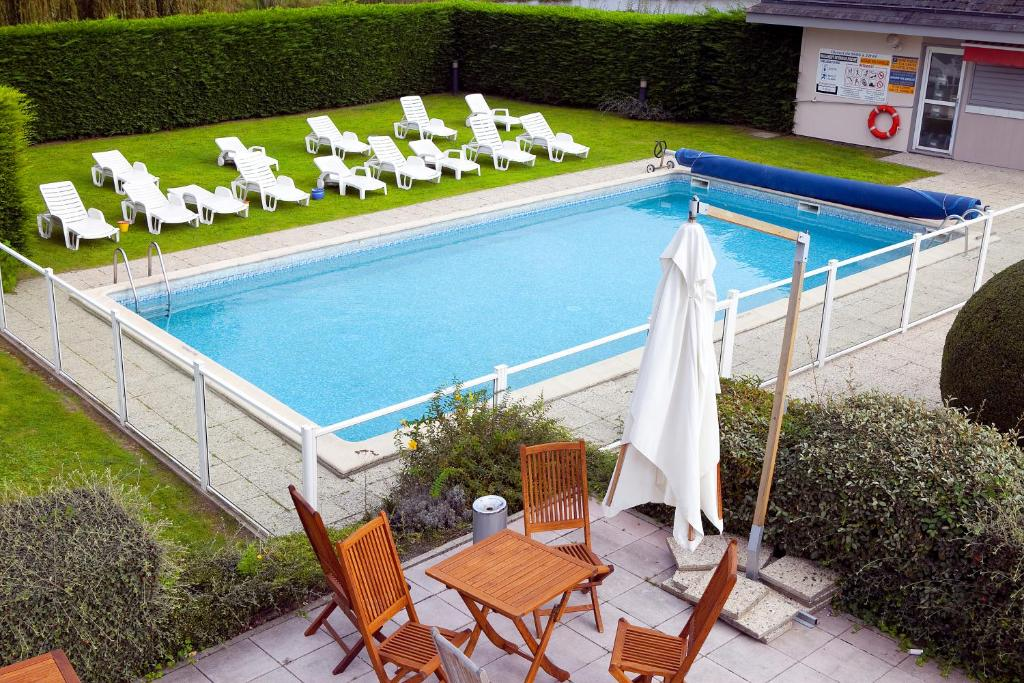 A view of the pool at Kyriad Deauville - St Arnoult or nearby
