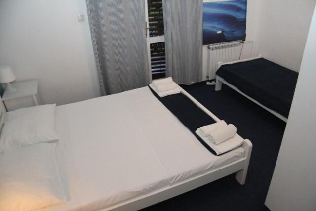 Krevet ili kreveti u jedinici u objektu Family apartment Pikolo