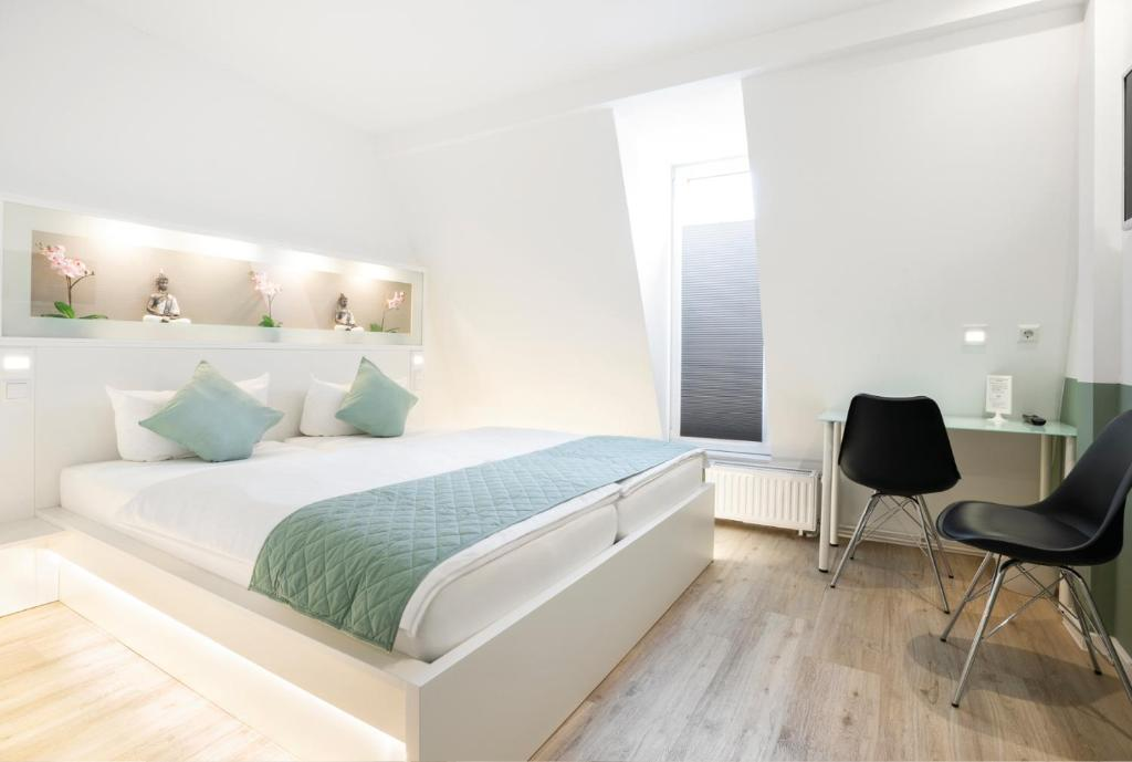 A bed or beds in a room at bedpark Stellingen