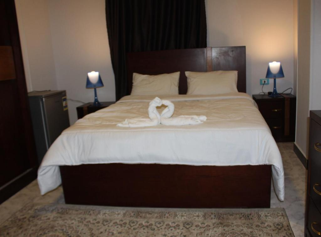 A bed or beds in a room at Magic Golden pyramids Inn