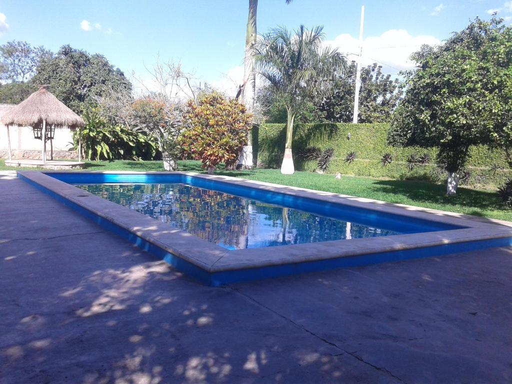 The swimming pool at or near Hotel Santa María Homun