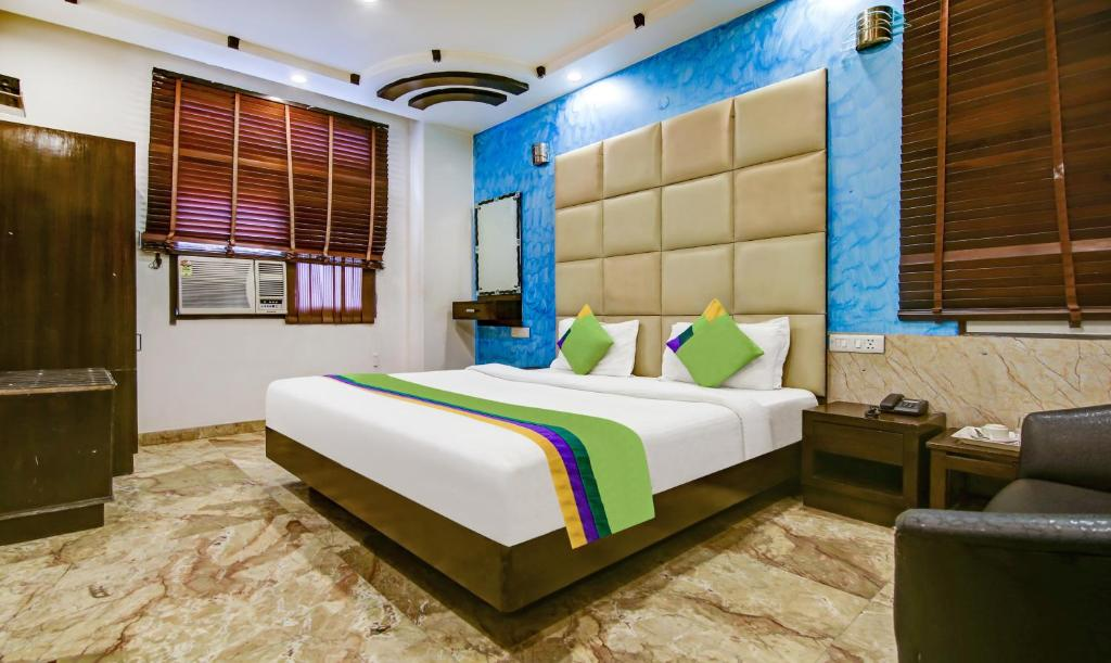 A bed or beds in a room at Treebo Trend Sehej Inn