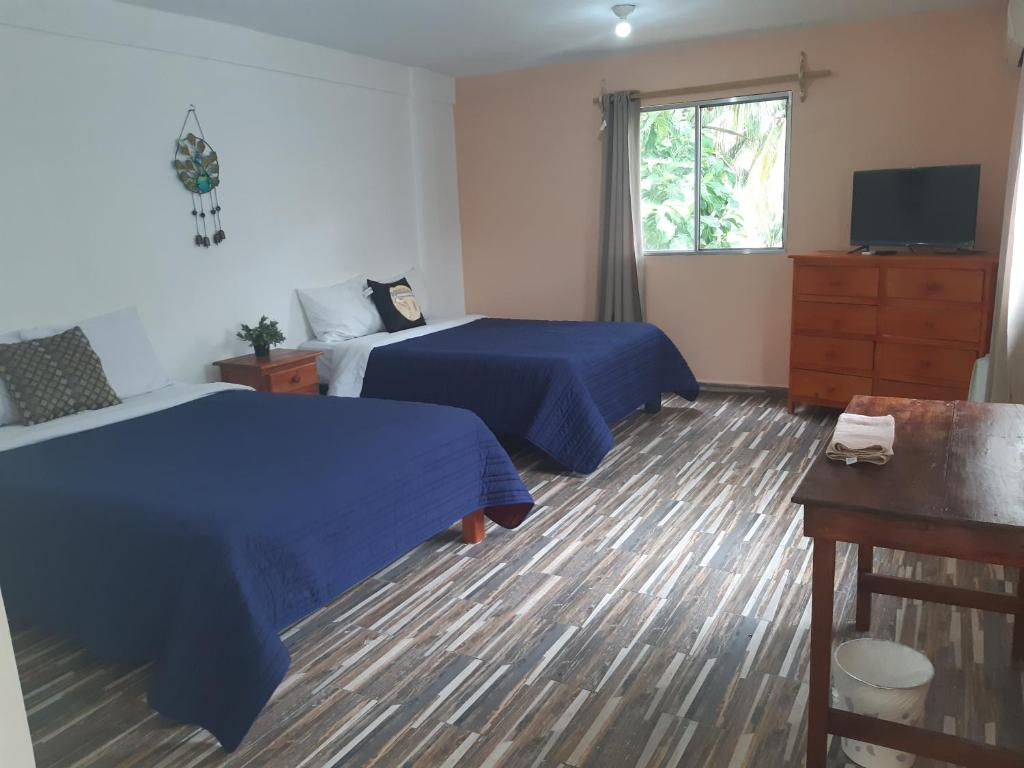 A bed or beds in a room at Mansion Giahn Bed & Breakfast