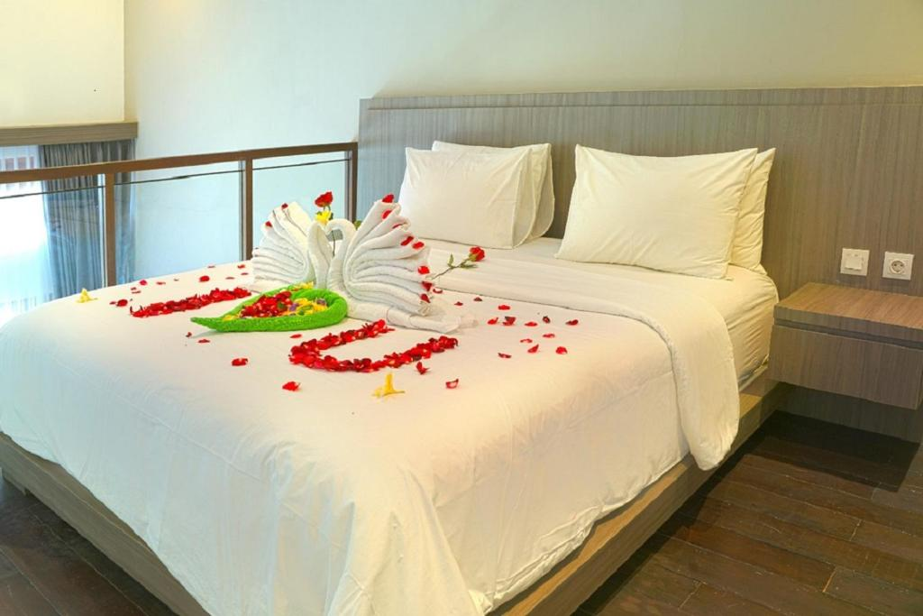 A bed or beds in a room at The Tanjung Seminyak Suites
