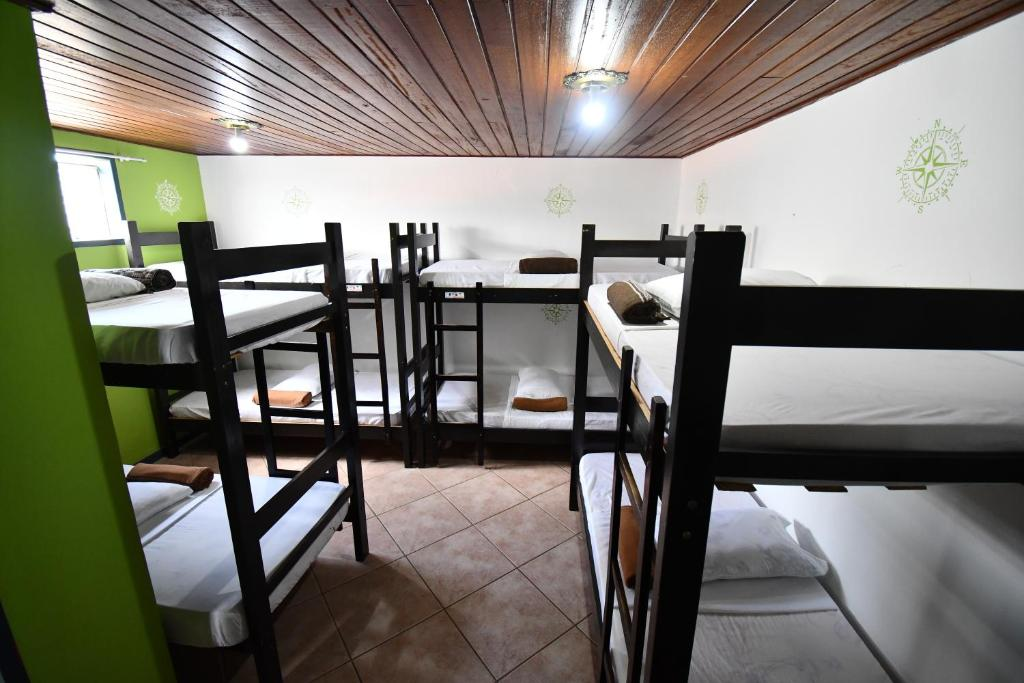 A bunk bed or bunk beds in a room at The Queen Hostel