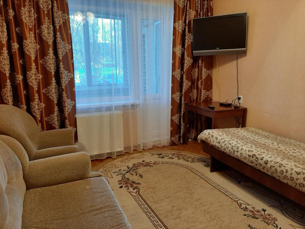 Кровать или кровати в номере Апартаменты на Трнавского