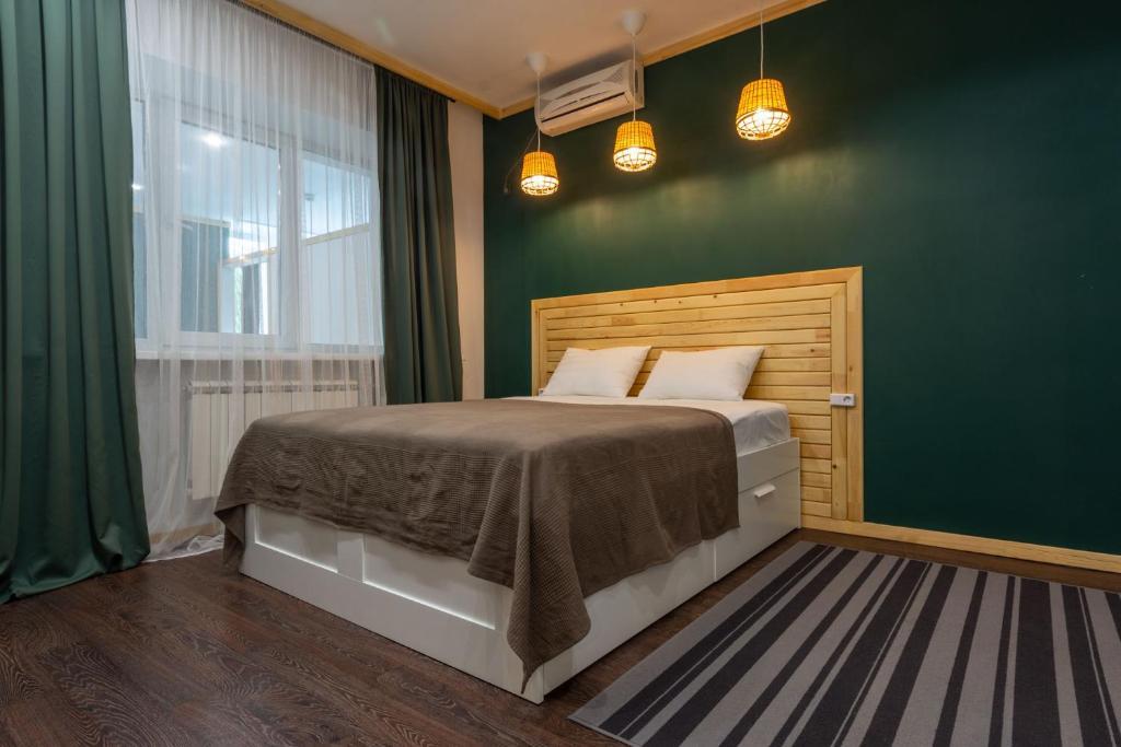 Кровать или кровати в номере Гостиничный Комплекс Золотой Дракон