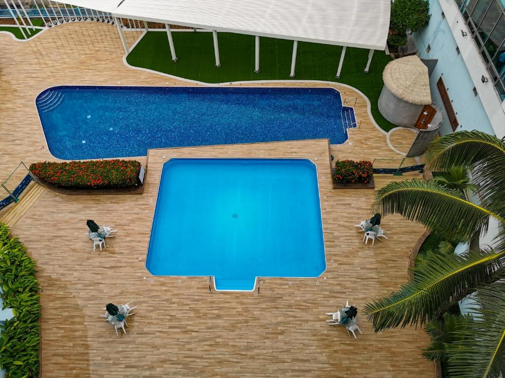 A view of the pool at Palasia Hotel or nearby