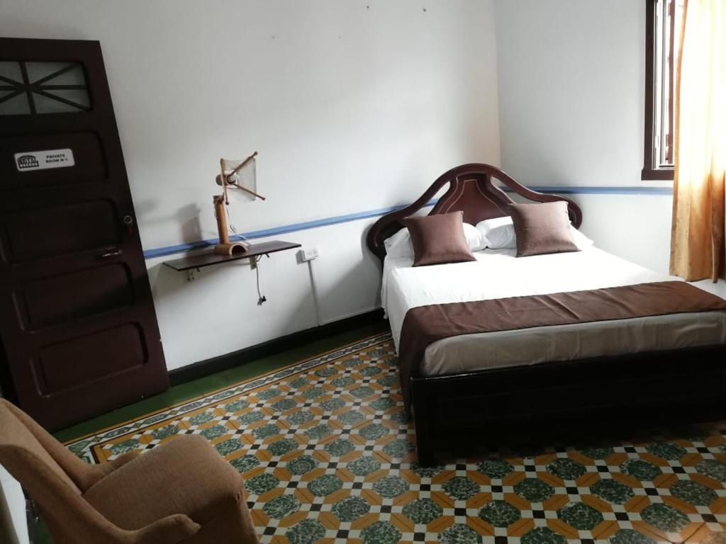 A bed or beds in a room at Buga Hostel