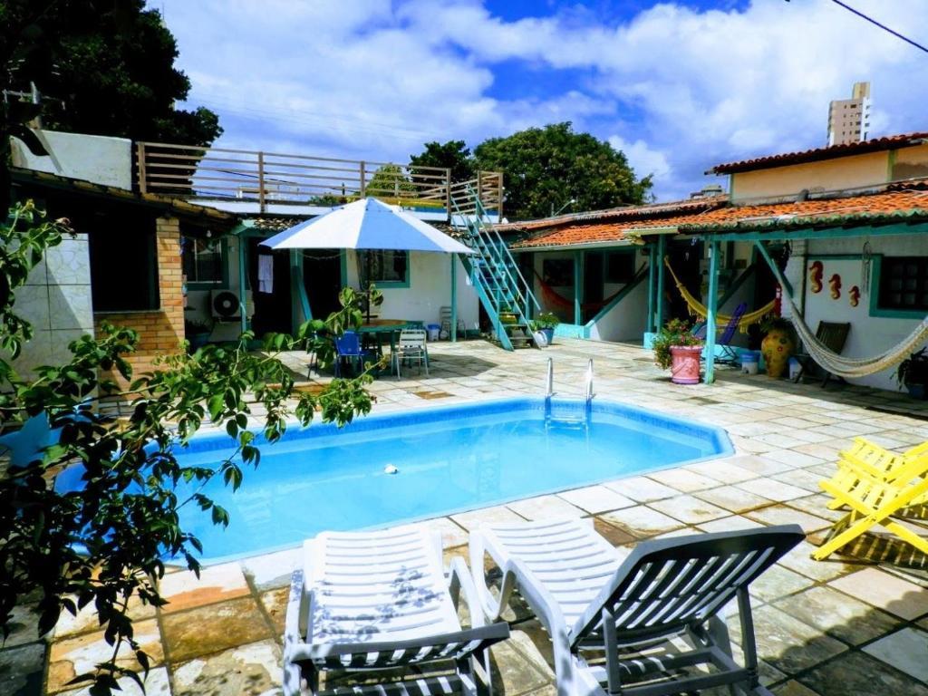 A piscina localizada em Pousada Brasil Natal ou nos arredores