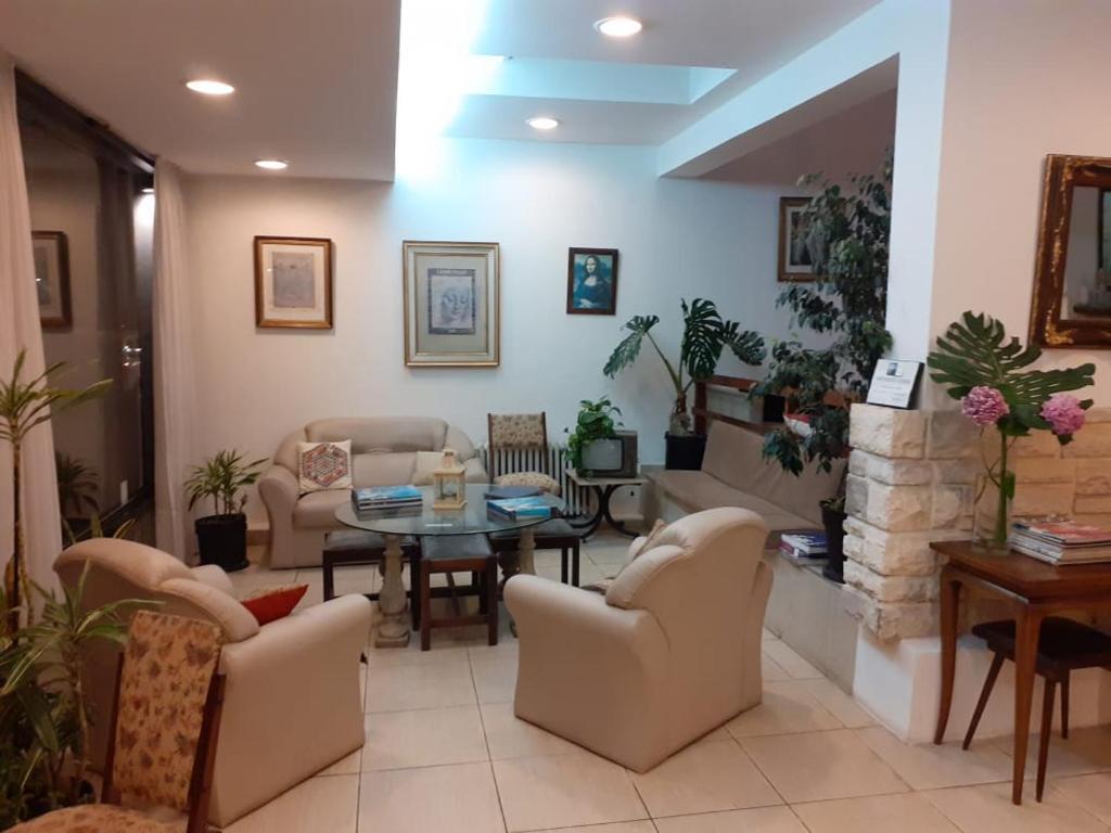 The lobby or reception area at Pofi Hotel