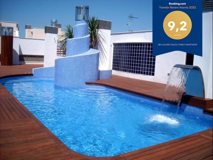 The swimming pool at or near T&H LLEVANT SALOU FAMILY APARTMENT