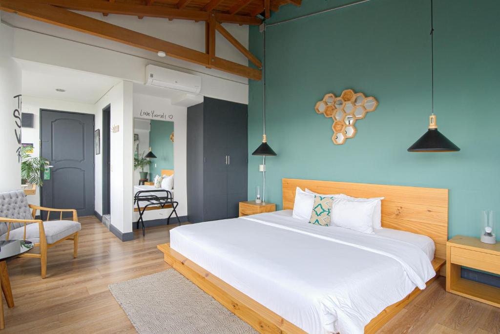 A bed or beds in a room at Selina Medellin