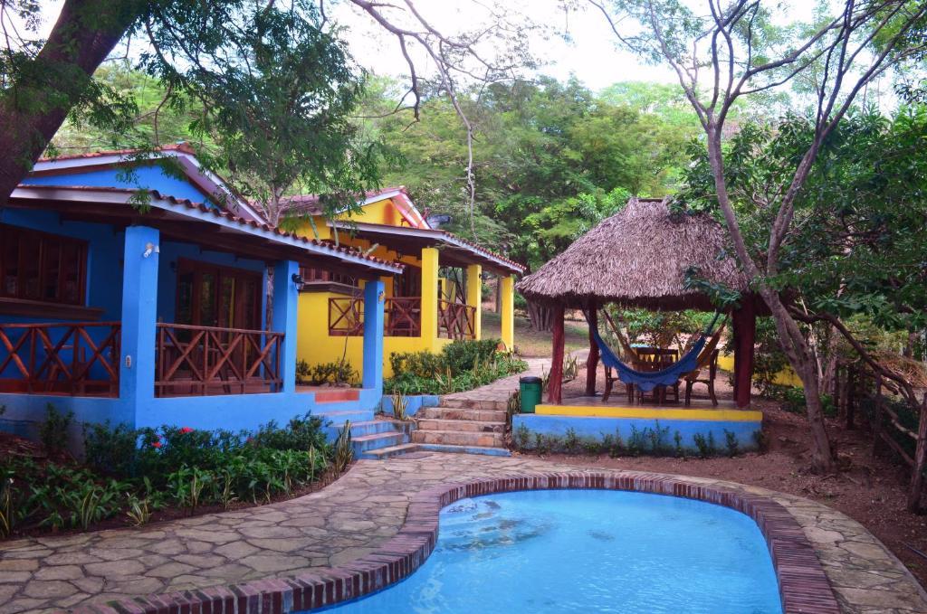 The swimming pool at or near Los Volcanes Playa el Coco