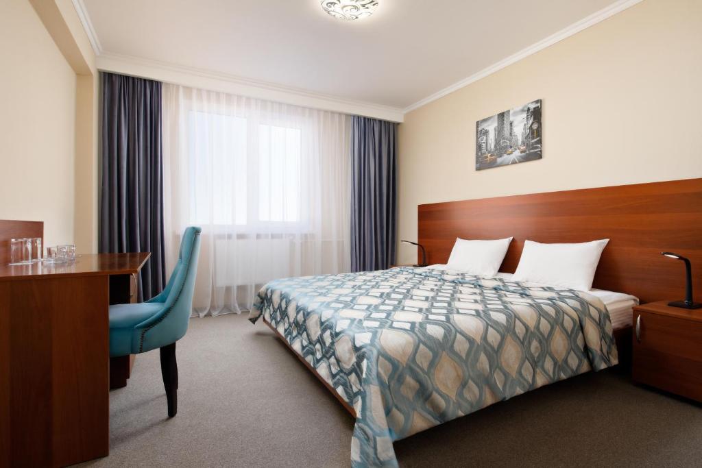 Кровать или кровати в номере Гостиница Континент