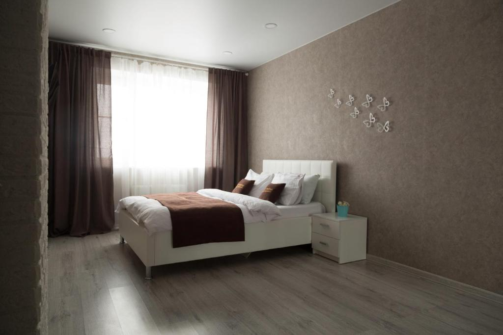 A bed or beds in a room at InnDays Объездная дорога 1 9й эт
