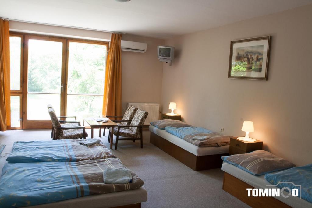 Posteľ alebo postele v izbe v ubytovaní Penzión Heinola