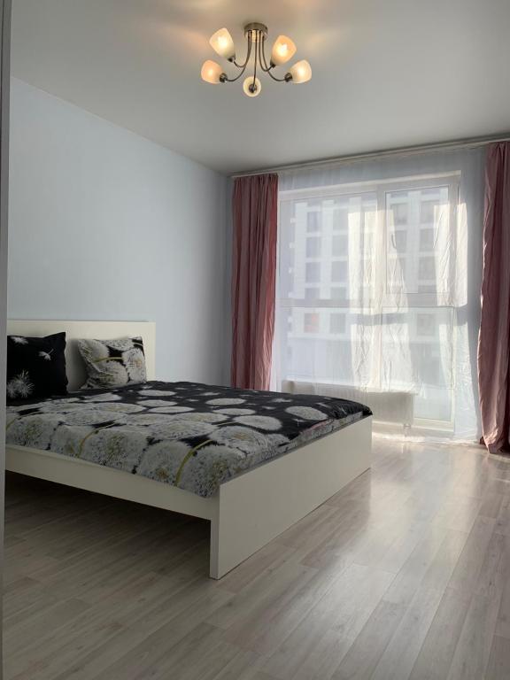 Кровать или кровати в номере Апартаменты Акварель 3