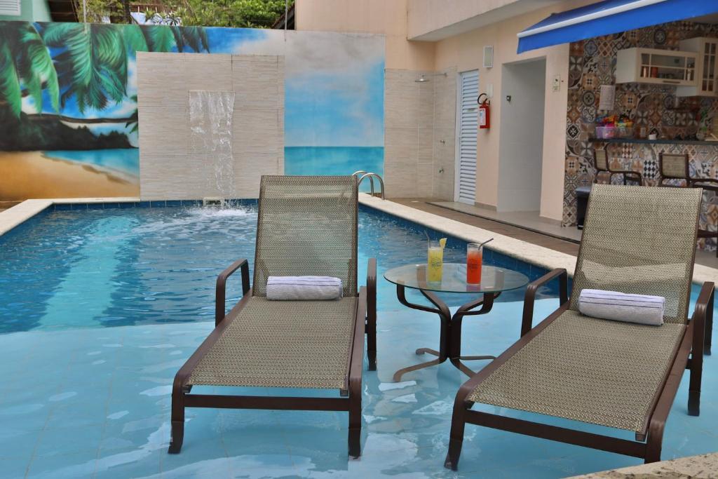 A piscina localizada em Pousada Em Cantos do Mundo ou nos arredores
