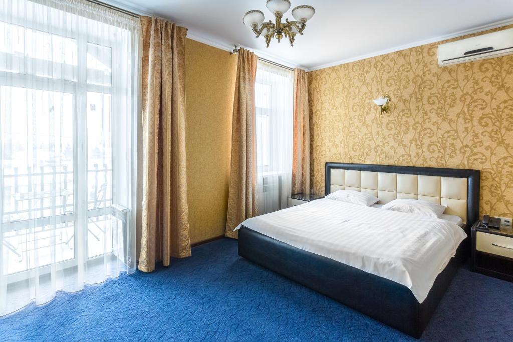 Кровать или кровати в номере Гостиничный Комплекс Пано Кастро
