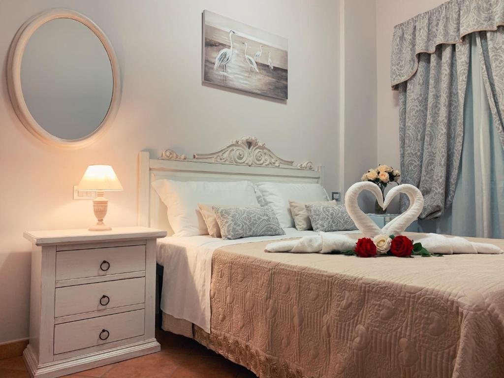 Letto o letti in una camera di B&B Vico d'Ercole