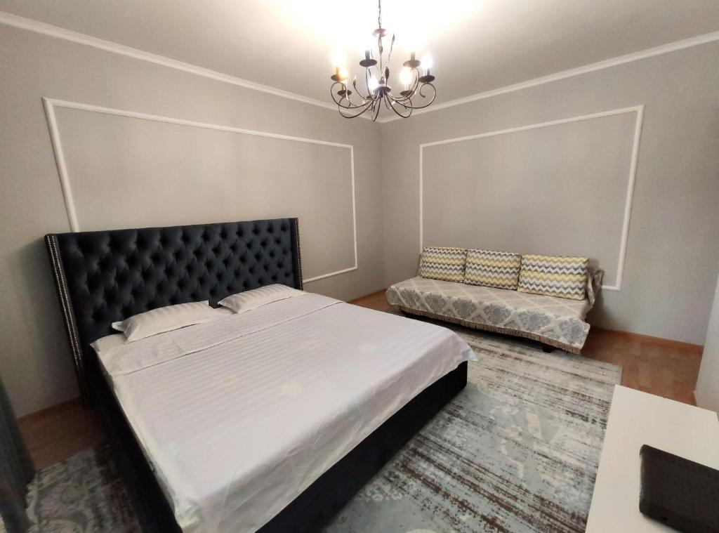 A bed or beds in a room at Apartments in Residential Complex Almaly, 69