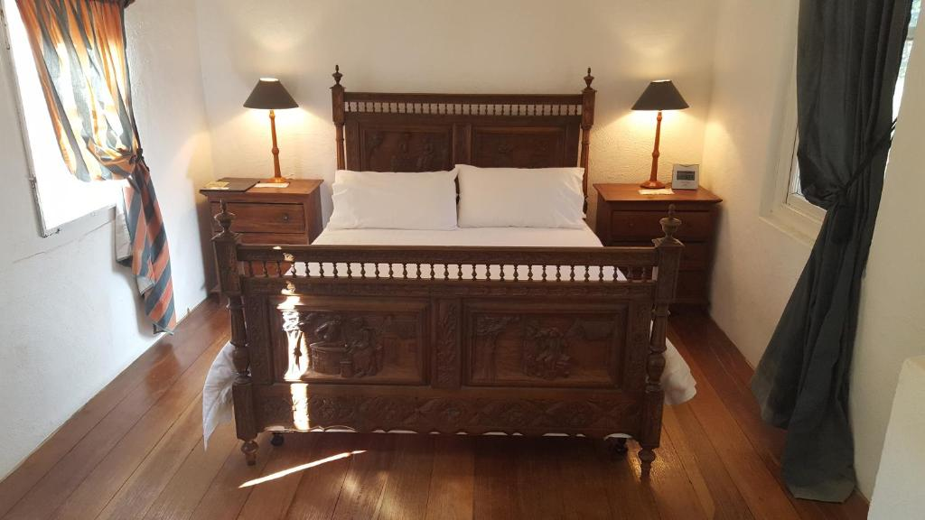 A bed or beds in a room at Courtyard Faversham House