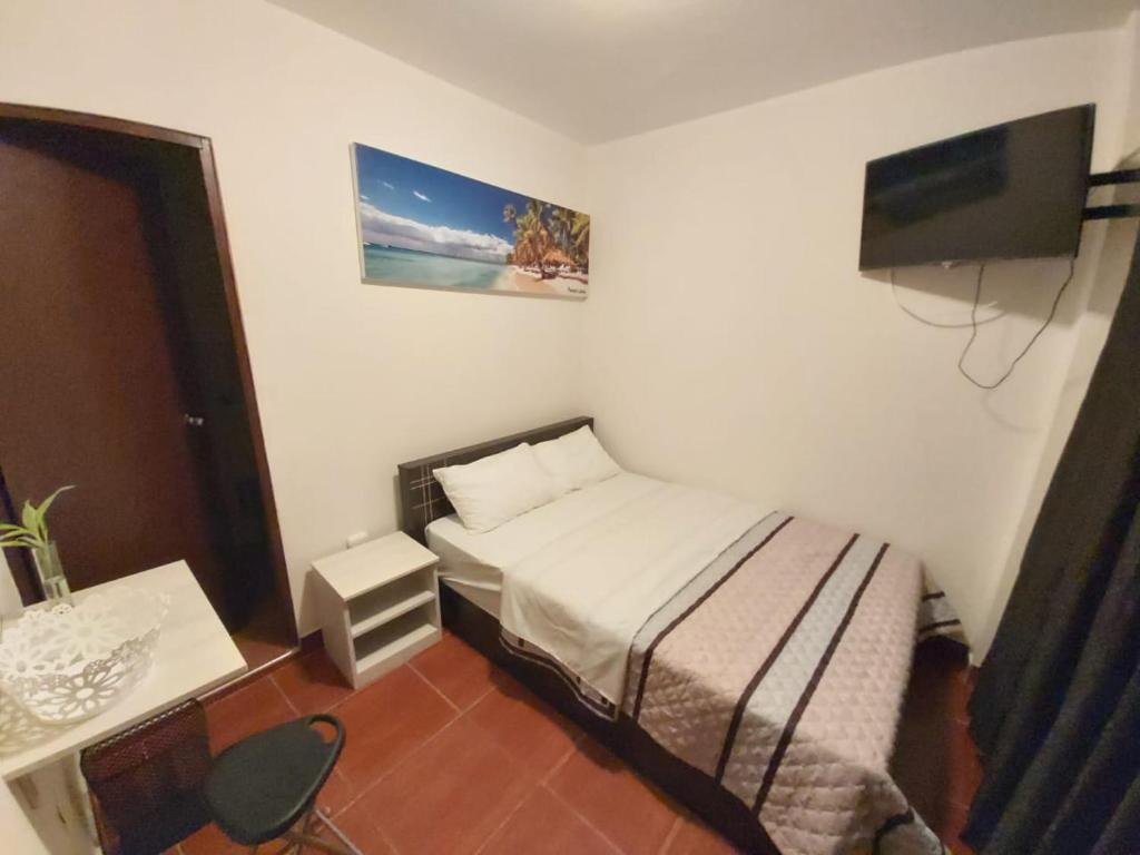 A bed or beds in a room at HOSPEDAJE LA CASITA