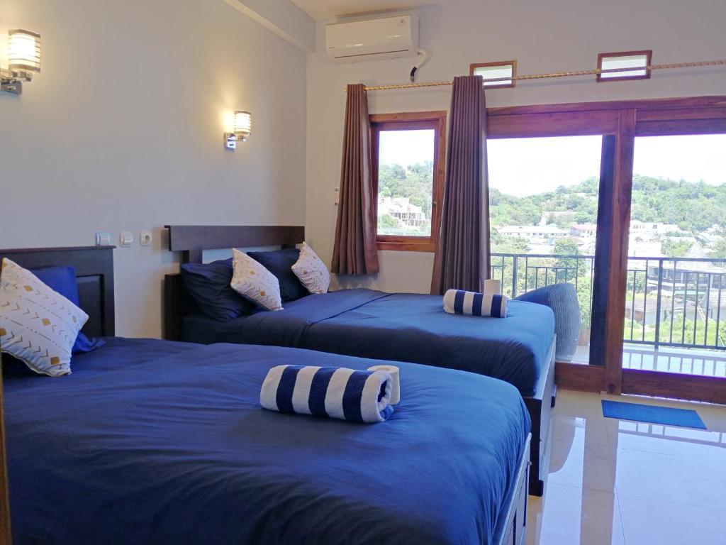 Een bed of bedden in een kamer bij Hotel Bonne Nuit